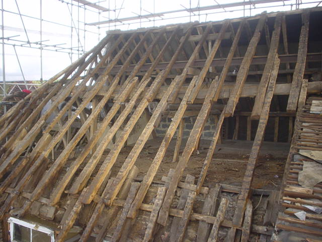 Cornstores roof being stripped